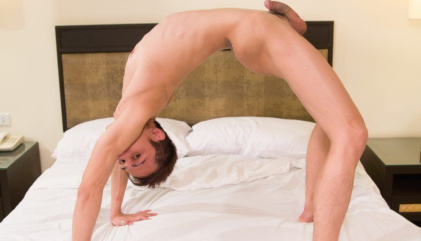 Asian boy doing Yoga naked